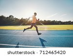fit and focused young african... | Shutterstock . vector #712465420
