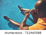 young african male runner in... | Shutterstock . vector #712465588