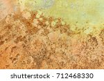 rusted painted metal wall.... | Shutterstock . vector #712468330