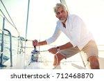 mature man standing on the deck ... | Shutterstock . vector #712468870