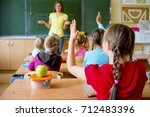 kids in classroom | Shutterstock . vector #712483396