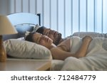 the sleeping man and woman on... | Shutterstock . vector #712484779