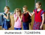 kids bully at school | Shutterstock . vector #712485496