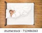the happy woman lay on the bed. ... | Shutterstock . vector #712486363