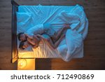 the man hug a woman on the bed. ... | Shutterstock . vector #712490869