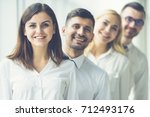 the happy business people stand ... | Shutterstock . vector #712493176