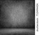 dark room with tile floor and... | Shutterstock . vector #712494424