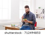 Healthy eating in office, man has lunch with fresh salad, copy space - stock photo