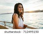 portrait of a beautiful latin... | Shutterstock . vector #712495150