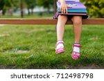 a young little girl preparing... | Shutterstock . vector #712498798