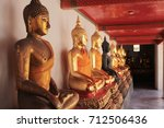 row of buddhas in gold and... | Shutterstock . vector #712506436