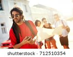 group of attractive tourists... | Shutterstock . vector #712510354