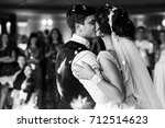 Bride And Groom Kiss Each Othe...