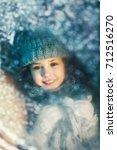 portrait of a little girl in a... | Shutterstock . vector #712516270