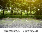 empty space in a parking lot... | Shutterstock . vector #712522960