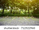 empty space in a parking lot... | Shutterstock . vector #712522960