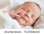 newborn infant at the hospital | Shutterstock . vector #712536610