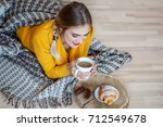 young girl drinking latte and... | Shutterstock . vector #712549678