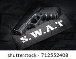 swat weapon and equipment on... | Shutterstock . vector #712552408