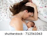 young mother breastfeeds her... | Shutterstock . vector #712561063