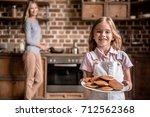 cute little girl is holding... | Shutterstock . vector #712562368