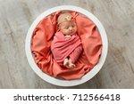 newborn baby in pink blanket... | Shutterstock . vector #712566418