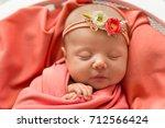newborn baby in pink blanket...   Shutterstock . vector #712566424