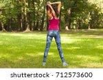 young woman stretches her body