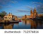 amsterdam canal and church of... | Shutterstock . vector #712576816