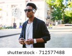 portrait of young stylish... | Shutterstock . vector #712577488