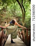 young woman practice yoga... | Shutterstock . vector #712580500