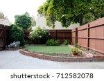 small backyard of a condo | Shutterstock . vector #712582078