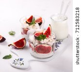 eton mess. fresh figs with... | Shutterstock . vector #712583218
