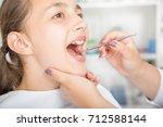 close up of little girl opening ... | Shutterstock . vector #712588144