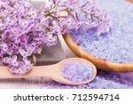 spa sea salt and flower branch... | Shutterstock . vector #712594714