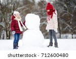 two adorable little girls... | Shutterstock . vector #712600480