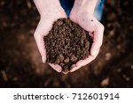 soil in hand  palm  cultivated... | Shutterstock . vector #712601914