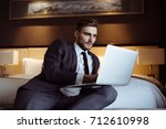 young handsome businessman... | Shutterstock . vector #712610998