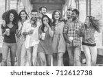 happy friends walking in city... | Shutterstock . vector #712612738