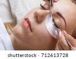 Small photo of Eyelash Extension Procedure. Woman Eye with Long Eyelashes. Lashes, close up, macro, selective focus.