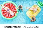 Happy friends having fun inside swimming pool - Young people enjoying summer holidays vacation in tropical hotel resort - Travel,holidays,youth and friendship concept - Warm filter