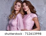 portrait of two woman wear... | Shutterstock . vector #712613998