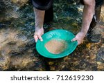 gold pan filled with mineral...   Shutterstock . vector #712619230