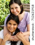 hispanic mother and daughter. | Shutterstock . vector #712621918