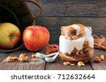 autumn baked apple parfait with ... | Shutterstock . vector #712632664
