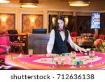 cute lady casino dealer at... | Shutterstock . vector #712636138