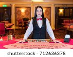 cute lady casino dealer at... | Shutterstock . vector #712636378