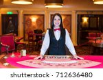 cute lady casino dealer at... | Shutterstock . vector #712636480
