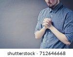 closeup on a young man pray ... | Shutterstock . vector #712646668