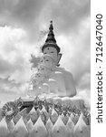 Small photo of black and white tone of multiple of buddha statue overlapping in the public temple in Thailand